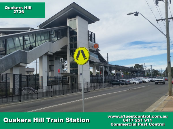 Picture of Quakers Hill Train Station taken from across the street facing the station.